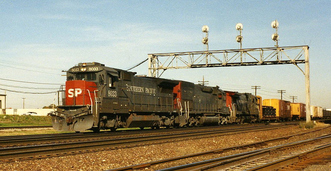 SP 8033, a GE Dash 8-39B, leads a westbound train through Eola, Illinois (just east of Aurora), October 6, 1992.
