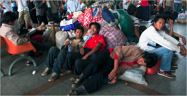 Migrant workers waiting for a train in Beijing - NY Times