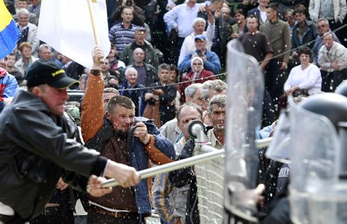 Protesters clash with police in front of the government building in Sarajevo