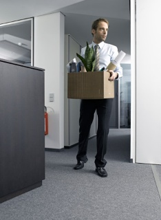 Businessman carrying office belongings