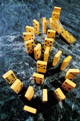 Falling dominoes arranged in dollar sign shape